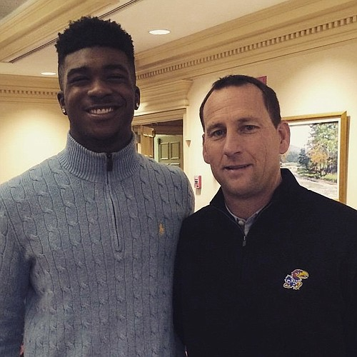 New KU safety Denzel Feaster with head coach David Beaty during a recent visit.