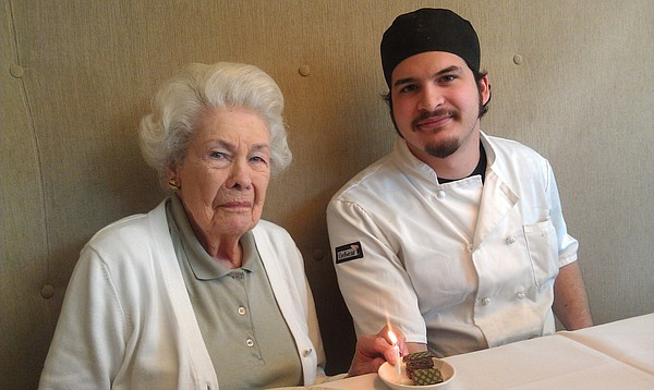 Betty Jane Moore, shown here with former Pachamamas pastry chef Jay Tovar-Ballagh on her 97th birthday, is celebrating her 100th birthday at the restaurant a few weeks early this year.