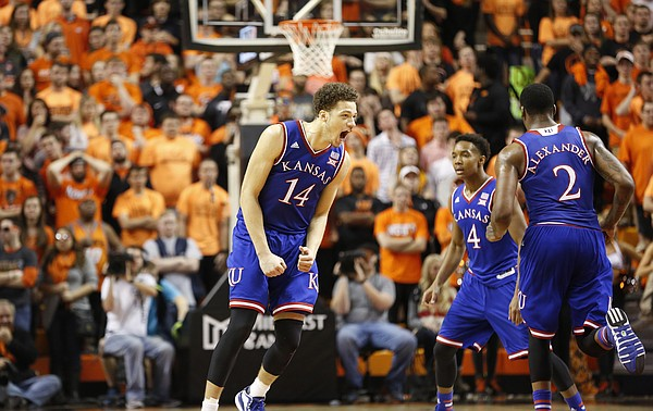 Kansas guard Brannen Greene (14) roars after a three during the first half on Saturday, Feb. 7, 2015 at Gallagher-Iba Arena.