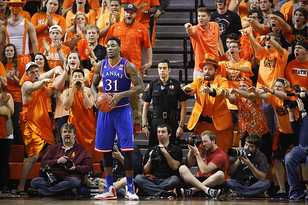 Kansas forward Jamari Traylor (31) takes some ribbing from the Oklahoma State student section before inbounding the ball during the second half on Saturday, Feb. 7, 2015 at Gallagher-Iba Arena.