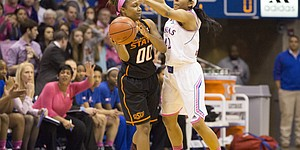 Kansas senior Natalie Knight pressures Oklahoma State sophomore Roshunda Johnson (00) during the annual Jayhawks for a Cure game Saturday evening at Allen Fieldhouse.