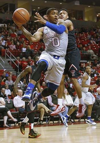 Kansas guard Frank Mason III, (0) passes from beneath the basket during the Jayhawks 73-51 win against Texas Tech Tuesday, Feb. 10, 2015 at United Supermarkets Arena.