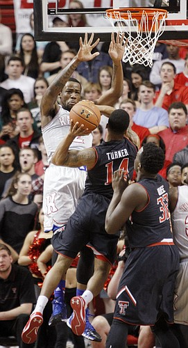 Kansas forward Cliff Alexander (2) left attempts a block on  Texas Tech guard Robert Turner (14) during the first half on Tuesday, Feb. 10, 2015 at United Supermarkets Arena.