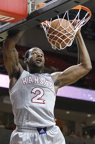 Kansas forward Cliff Alexander (2) dunks off a pass from Frank Mason III, in the second half of the Jayhawks 73-51 win over Texas Tech Tuesday, Feb. 10, 2015 at United Supermarkets Arena.