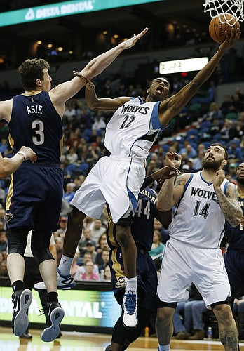 8bb0f82f745c Minnesota Timberwolves forward Andrew Wiggins (22) pushes up to the basket  against New Orleans