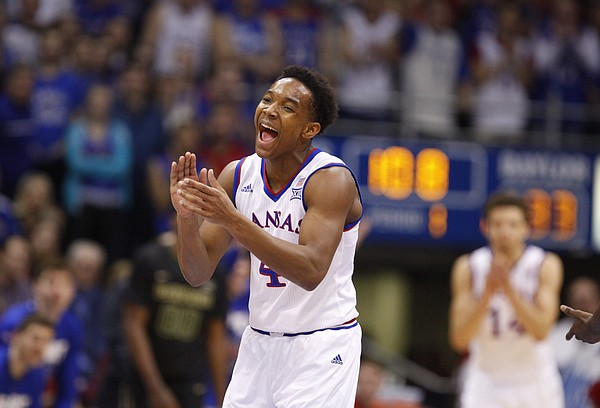 Kansas guard Devonte Graham (4) claps after forcing a turnover by Baylor guard Kenny Chery (1) during the first half, Saturday, Feb. 14, 2015 at Allen Fieldhouse.