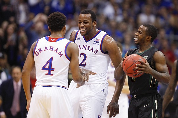 Kansas forward Cliff Alexander (2) comes in to celebrate with  guard Devonte Graham after Graham forced a turnover by Baylor guard Kenny Chery (1) during the first half, Saturday, Feb. 14, 2015 at Allen Fieldhouse.