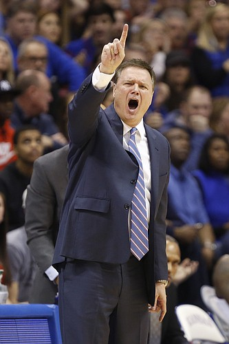 Kansas basketball coach Bill Self signals to his defense during the second half, Saturday, Feb. 14, 2015 at Allen Fieldhouse.