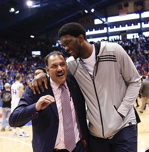 Philadelphia 76ers center Joel Embiid chats up Kansas assistant coach Kurtis Townsend on the way to the locker room following the Jayhawks' 74-64 win over Baylor on Saturday, Feb. 14, 2015 at Allen Fieldhouse.