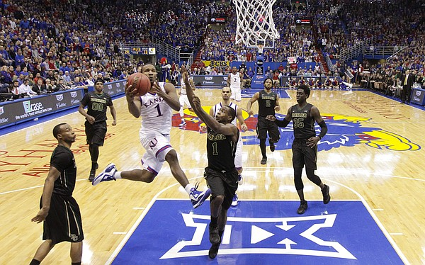Kansas guard Wayne Selden Jr. (1) soars in to the bucket as he is fouled by Baylor guard Kenny Chery (1) during the second half, Saturday, Feb. 14, 2015 at Allen Fieldhouse.