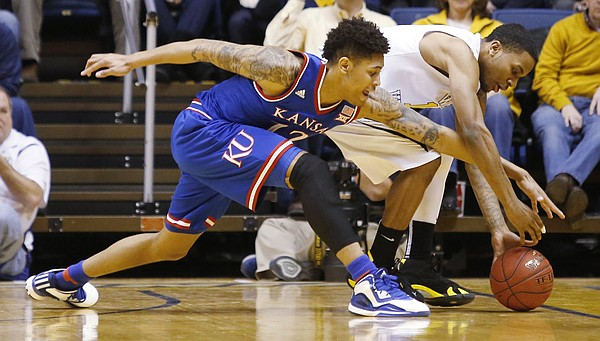 Kansas guard Kelly Oubre, Jr. (12) attempts a steal from West Virginia guard Tarik Phillip (12) during the Jayhawks 62-61 loss to the Mountaineers Monday, February 16, 2105  in Morgantown, W.V.