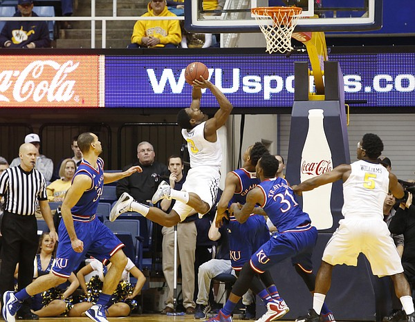 West Virginia guard Juwan Staten (3) jumps through the Kansas defense for shot during the Jayhawks game against the West Virginia Mountaineers Monday, February 16, 2105  in Morgantown, W.V. Staten led W.V. with 20 points and scored the winning basket in the game.