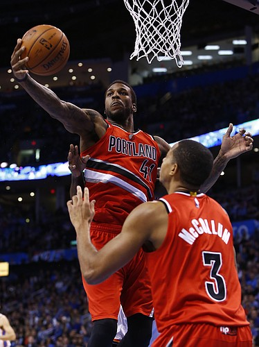 Portland Trail Blazers forward Thomas Robinson (41) grabs a rebound from the Oklahoma City Thunder during the fourth quarter of a NBA basketball game in Oklahoma City, Tuesday, Dec. 23, 2014. Portland won 115-111. (AP Photo/Alonzo Adams)