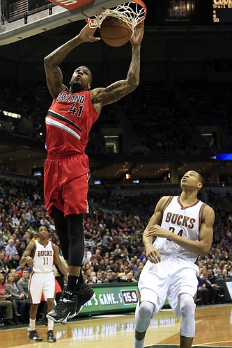 FILE — Portland Trail Blazers forward Thomas Robinson dunks against the Milwaukee Bucks during the first half of an NBA basketball game Saturday, Jan. 31, 2015, in Milwaukee. (AP Photo/Darren Hauck)