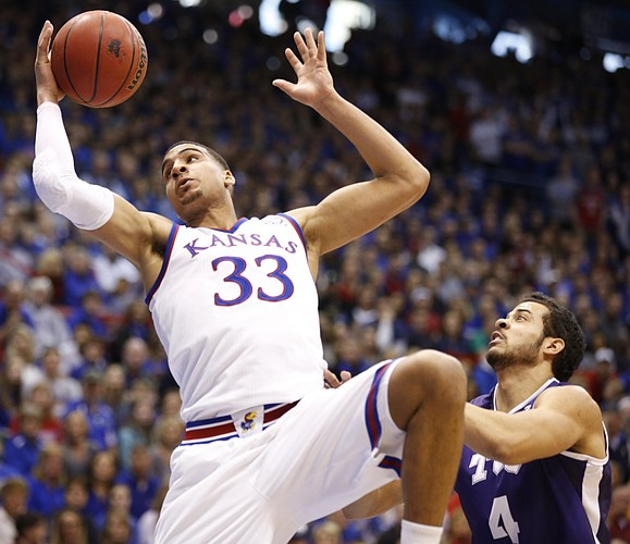 Kansas forward Landen Lucas (33) catches a pass in the paint before TCU forward Amric Fields (4) during the first half, Saturday, Feb. 21, 2015 at Allen Fieldhouse.