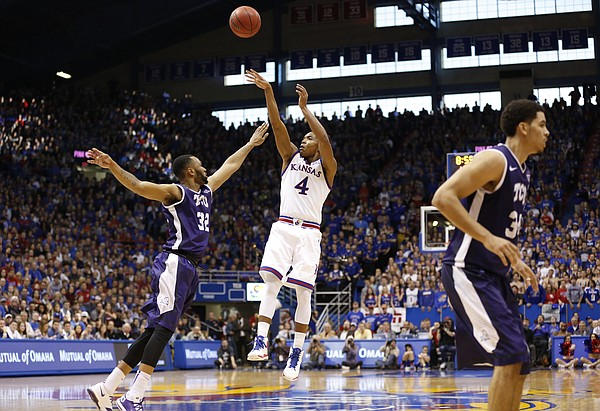 Kansas guard Devonte Graham (4) puts up a shot over TCU guard Trey Zeigler (32) during the second half, Saturday, Feb. 21, 2015 at Allen Fieldhouse.