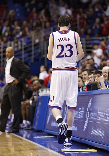 Kansas team manager Chris Huey checks into the game with less than a minute left, Saturday, Feb. 21, 2015 at Allen Fieldhouse.