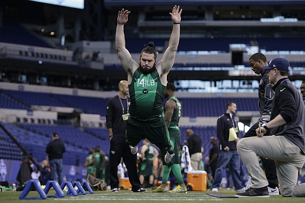 Kansas University linebacker Ben Heeney jumps during a drill at the NFL football scouting combine Sunday, Feb. 22, 2015, in Indianapolis.