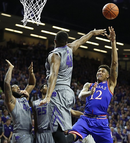 Kansas guard Kelly Oubre Jr. (12) pulls up for a shot against Kansas State forward Stephen Hurt (41) during the first half, Monday, Feb. 23, 2015 at Bramlage Coliseum.