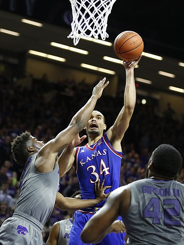 Kansas forward Perry Ellis (34) puts a shot up against Kansas State forward Nino Williams (11) during the first half, Monday, Feb. 23, 2015 at Bramlage Coliseum.