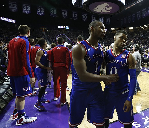 Kansas guard Wayne Selden Jr. (1) and guard Frank Mason III leave the floor following the Jayhawks' 70-63 loss to the Wildcats, Monday, Feb. 23, 2015 at Bramlage Coliseum.