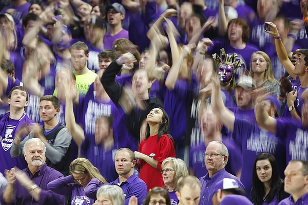A lone Kansas fan watches the scoreboard in the middle of a raucous sea of purple during the second half, Monday, Feb. 23, 2015 at Bramlage Coliseum.