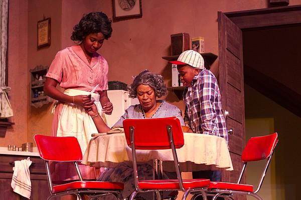 "From left, Diadra Smith, Catherine A. Collins and Tripp Starr rehearse a scene from ""Raisin in the Sun"" on Wednesday at Crafton-Preyer Theatre in Murphy Hall. The KU University Theatre production opens Friday, and is in conjunction with Theatre Lawrence's production of ""Clybourne Park,"" which also opens Friday and runs through March 8."