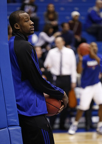 Kansas forward Cliff Alexander watches warmups on Saturday, Feb. 28, 2015 at Allen Fieldhouse. Kansas University officials announced that Alexander will not play against Texas after they were alerted to a potential eligibility issue involving Alexander by the NCAA.