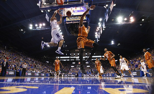 Kansas forward Perry Ellis (34) delivers a dunk against Texas center Prince Ibeh during the first half on Saturday, Feb. 28, 2015 at Allen Fieldhouse.