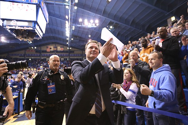 Kansas head coach Bill Self applauds the crowd as he leaves the floor following the Jayhawks' 69-64 win over Texas on Saturday, Feb. 28, 2015 at Allen Fieldhouse.