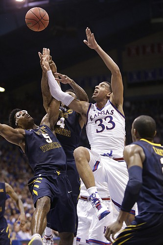 Kansas forward Landen Lucas (33) battles for a rebound during the Jayhawks game against the West Virginia Mountaineers Tuesday, March 4, 2015 at Allen Fieldhouse.