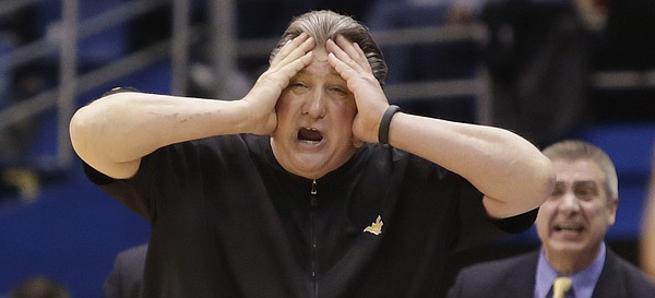 West Virginia coach Bobby Huggins reacts to turnover near the end of regulation during the Jayhawks win against the West Virginia Mountaineers Tuesday, March 4, 2015 at Allen Fieldhouse.