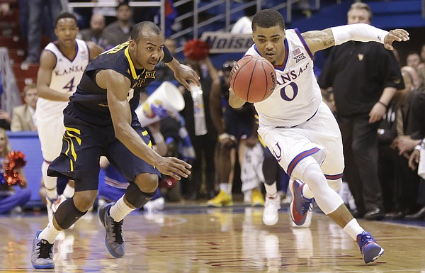 Kansas guard Frank Mason III (0) beats West Virginia guard Jevon Carter (2) to a steal Tuesday, March 4, 2015 at Allen Fieldhouse..