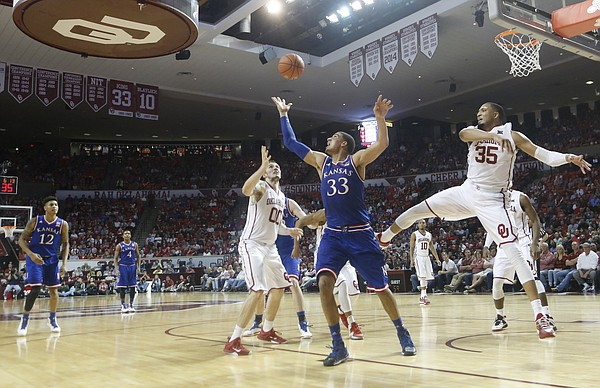 Kansas forward Landen Lucas (33) grabs a 2nd-half rebound during the Jayhawks 75-73 loss to the Oklahoma Sooners Saturday, March 7, 2015 in Norman.