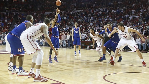 Kansas guard Frank Mason III (0) hits his 3rd free-throw in a row after being fouled on a 3-point attempt late in the Jayhawks 75-73 loss to the Oklahoma Sooners Saturday.