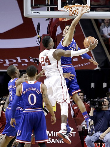 Kansas forward Landen Lucas (33) guards Oklahoma guard Buddy Hield (24) at the basket during the Jayhawks 75-73 loss to the Oklahoma Sooners Saturday.