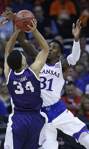 Kansas forward Jamari Traylor (31) blocks a shot by TCU's Kenrich Williams (34) in the first half of the Jayhawk's 64-59 win over TCU Thursday at the Sprint Center in Kansas City, MO.