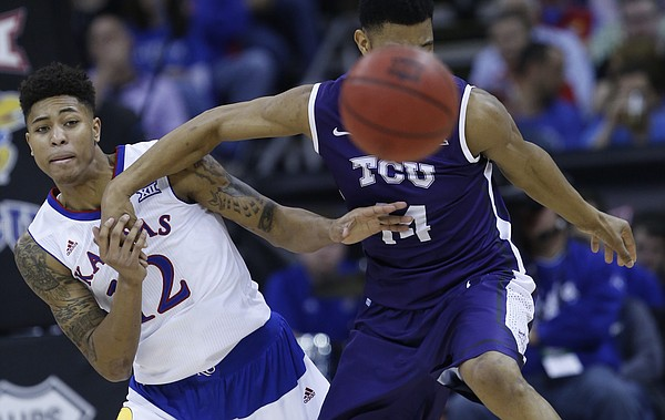 Kansas guard Kelly Oubre, Jr. (12) knocks the ball loose from TCU's Karviar Shepard (14) in the Jayhawk's 64-59 win over TCU Thursday at the Sprint Center in Kansas City, MO.