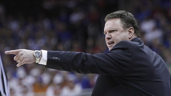Kansas coach Bill Self responds to a referees call in the second half of the Jayhawk's 64-59 win over TCU Thursday at the Sprint Center in Kansas City, MO.