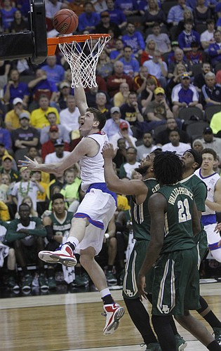 Kansas center Hunter Mickelson (42) reverses for two against Baylor Friday March 13, 2015 at the Sprint Center in Kansas City, Mo.
