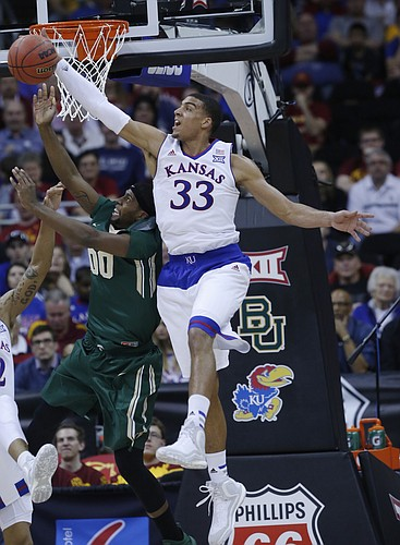 Kansas forward Landen Lucas (33) collects a rebound in the Jayhawk's 62-52 win over Baylor in the semi-final of the Big 12 Tournament Friday at the Sprint Center in Kansas City, MO.