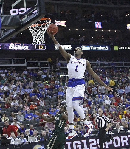 Kansas guard Wayne Selden Jr. (1) lays in two of his 20 points in the Jayhawk's 62-52 win over Baylor in the semi-final of the Big 12 Tournament Friday at the Sprint Center in Kansas City, MO.