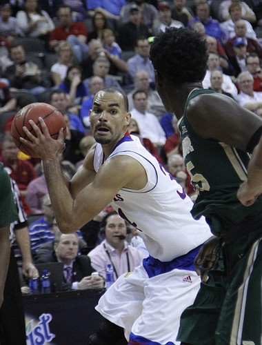 Perry Ellis (34) positions himself for a shot against Baylor's defense in the Jayhawk's 62-52 win over Baylor in the semi-final of the Big 12 Tournament Friday.