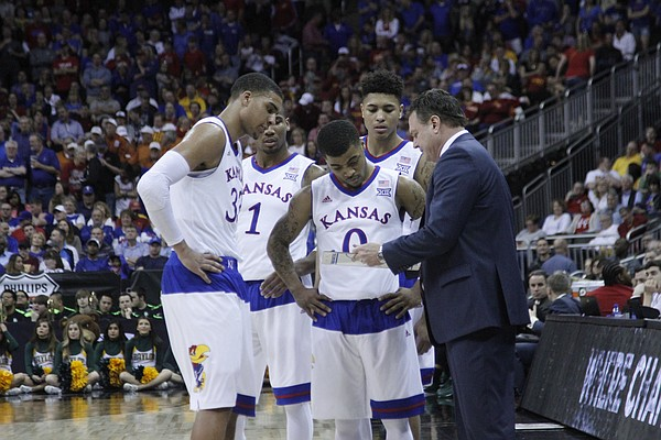KU coach Bill Self talks to the team during a timeout in the closing minutes of the Jayhawk's 62-52 win over Baylor in the semi-final of the Big 12 Tournament Friday.