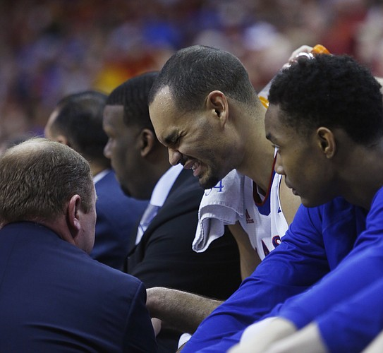 Kansas forward Perry Ellis (34) grimaces on the bench during the Jayhawk's loss to Iowa State in the championship game of the Big 12 Tournament Saturday.