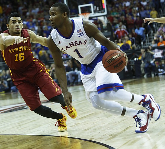 Kansas guard Wayne Selden Jr. (1) tries to drive on Iowa State's Naz Long (33) in the Jayhawk's 70-66 loss to Iowa State in the championship game of the Big 12 Tournament Saturday in Kansas City, MO.