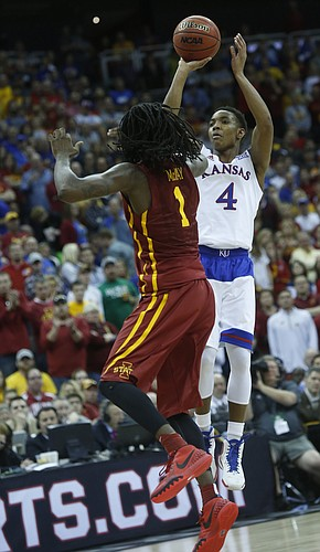 Kansas guard Devonte Graham (4) shoots for a three-point basket over Iowa State's Jameel McKay during the Jayhawk's loss to Iowa State Saturday.