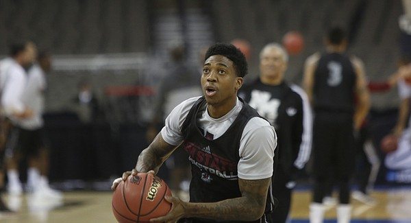 New Mexico State senior guard Daniel Mullings warms up with his team during a practice session at the CenturyLink Center in Omaha, NE., Thursday, March 19, 2015.