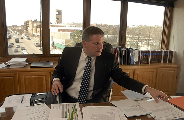 In this file photo from 2008, Lawrence city manager David Corliss is shown at his City Hall office overlooking Massachusetts Streets.