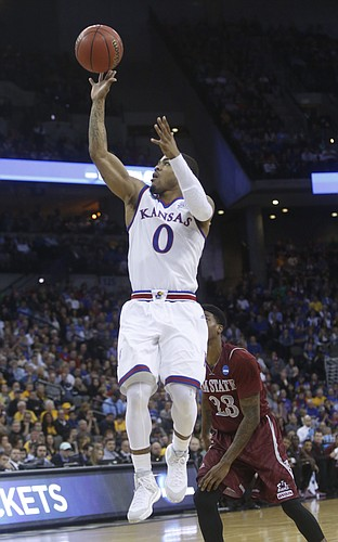 Kansas guard Frank Mason III (0) lays in two of his 17 points in the Jayhawks' 75-56 win against New Mexico State Friday, March 20, 2015 at the CenturyLink Center, Omaha, NE.